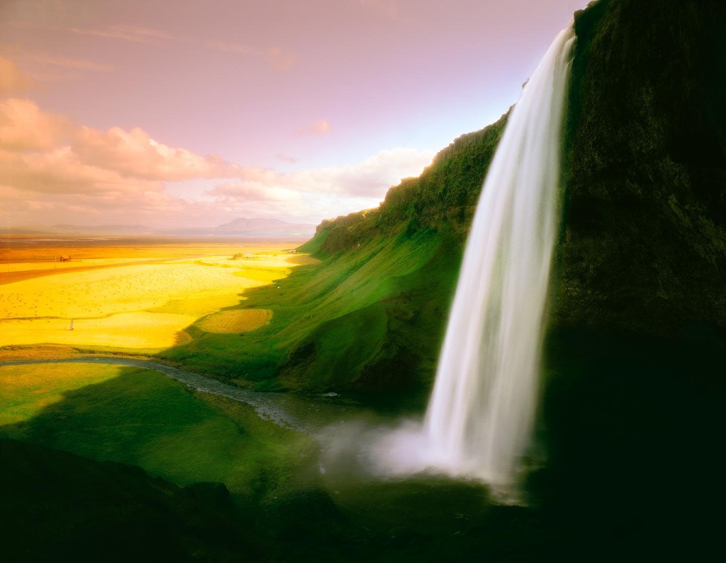 Icelandic landscape by photographer Ron Bambridge. This is the Seljalandsfoss waterfall on the south side of the island